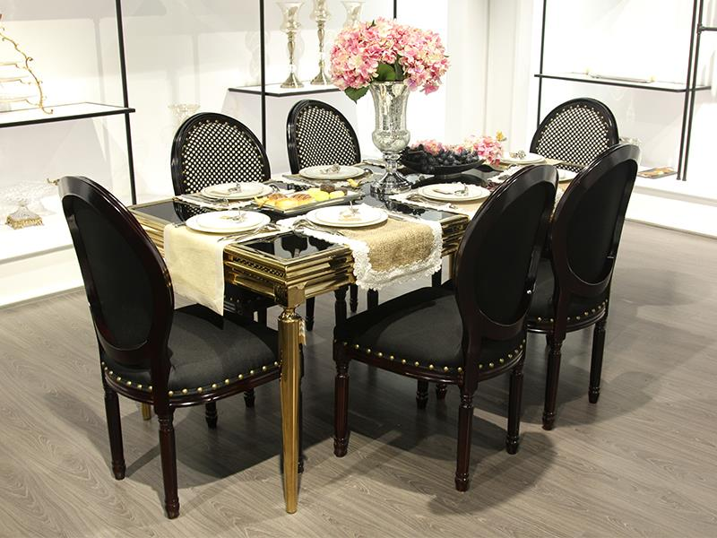 glass black dining table with gold detail. Black Bedroom Furniture Sets. Home Design Ideas